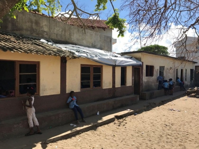 A classroom with a tarpaulin for a roof